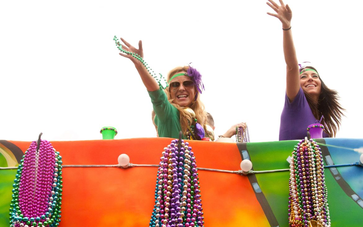 Attractive young women on madri gras parade float