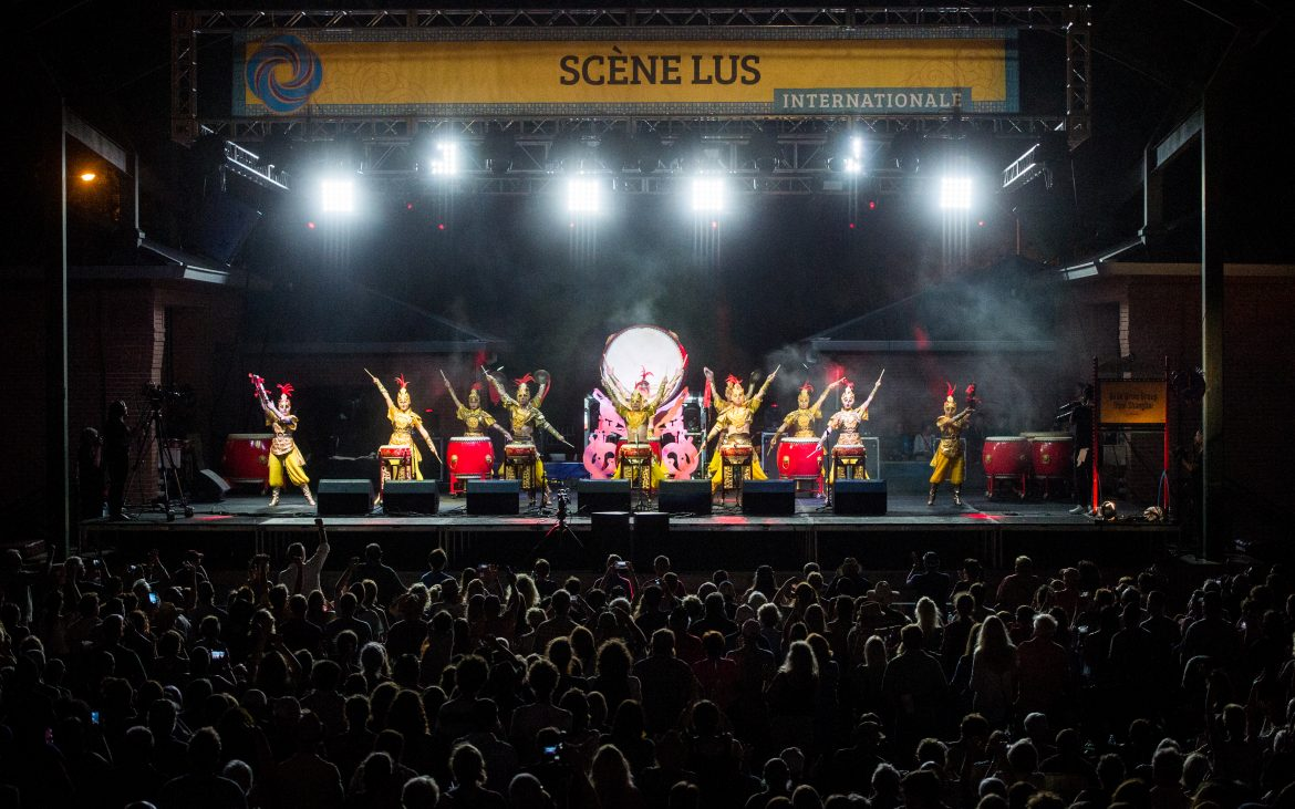 Colorful dancers performing on large well-lit stage