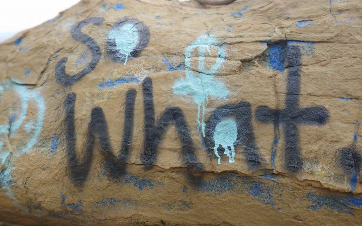 So What graffiti on rock