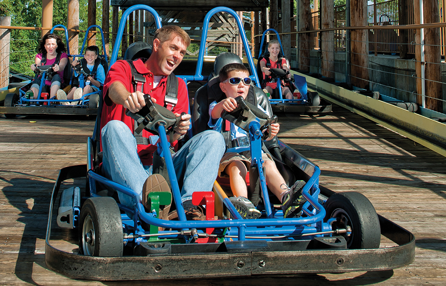 A go-karts race along a wooden track in Branson, Missouri.