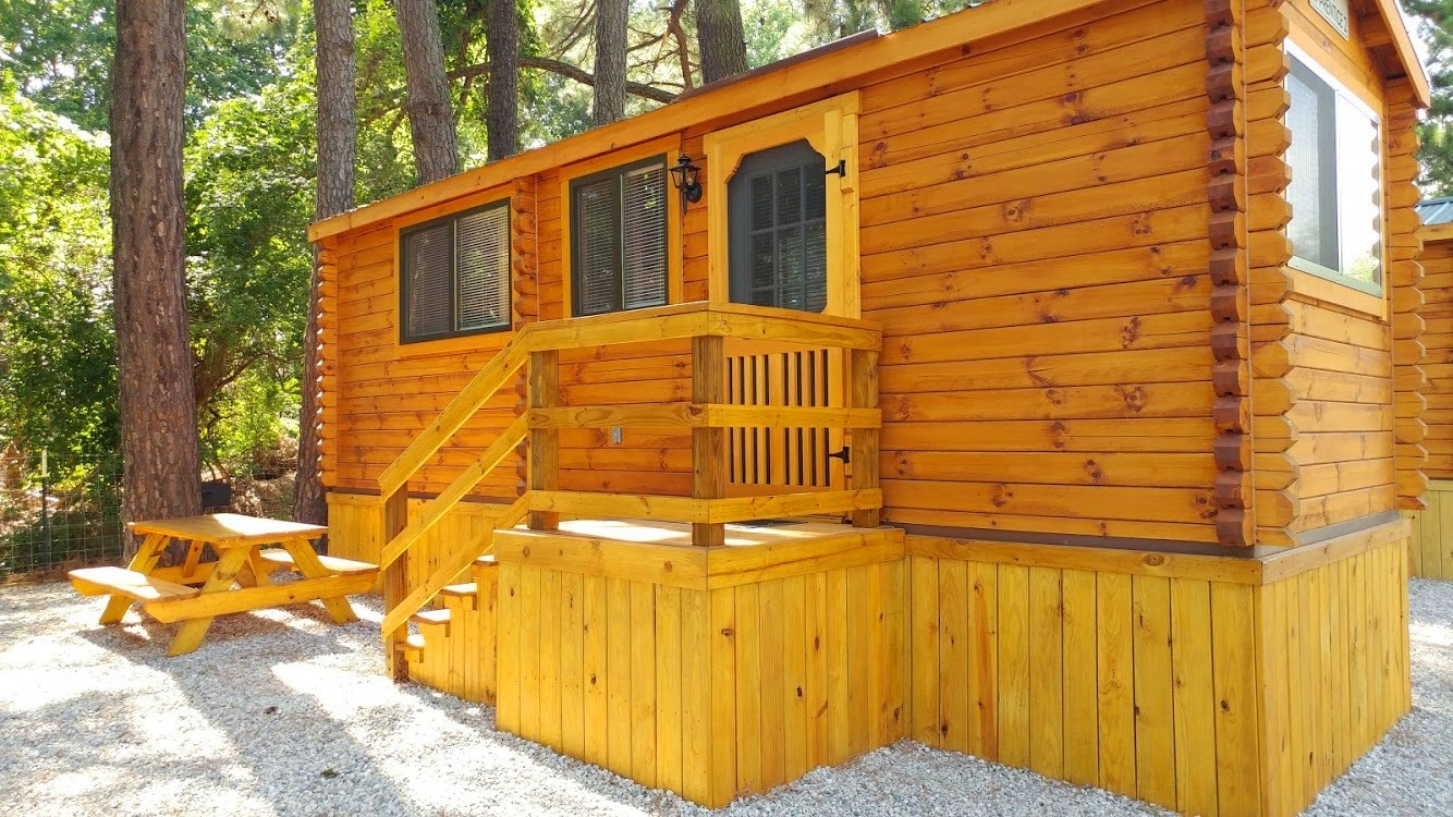 A camping cabin with a smooth wooden exterior.