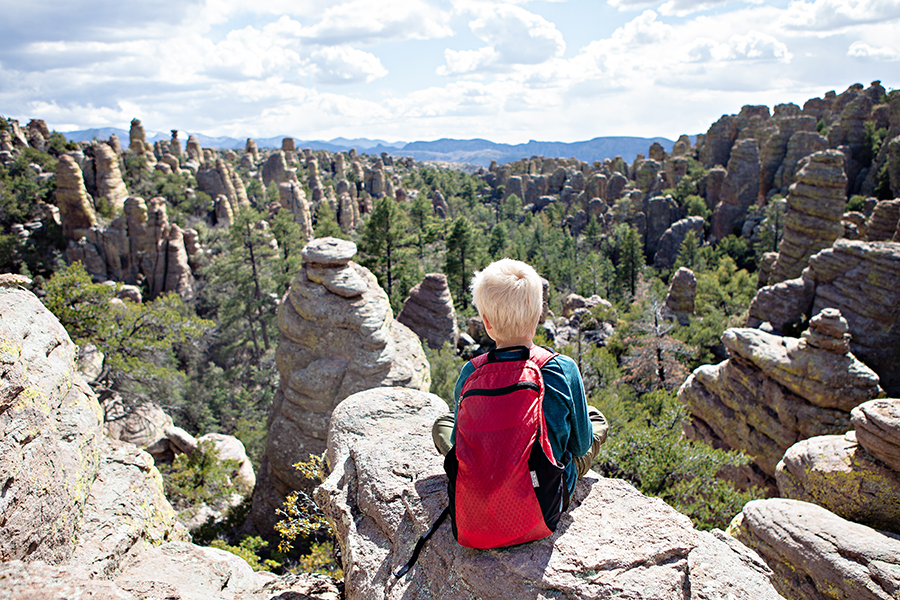 A child enjoying the view of hoodoo formations at Chiricahua National Monument.