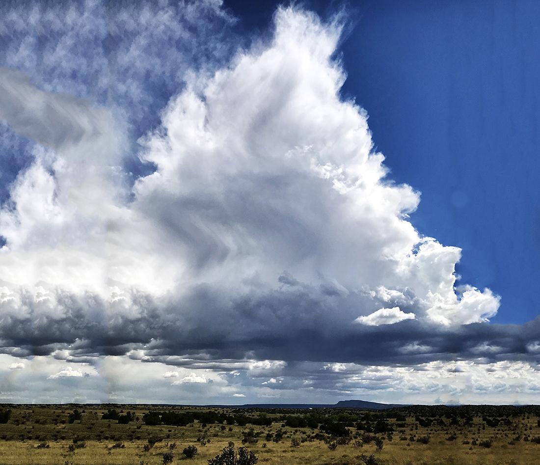 Clouds hang dramatically over an endless horizon.