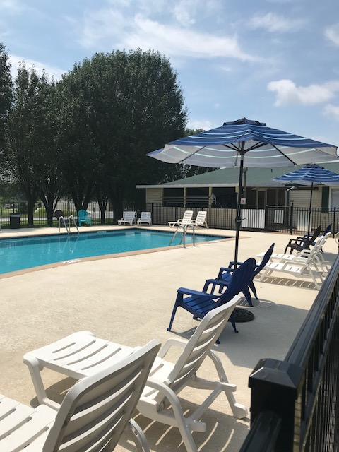 Lounge chairs and umbrella by pool