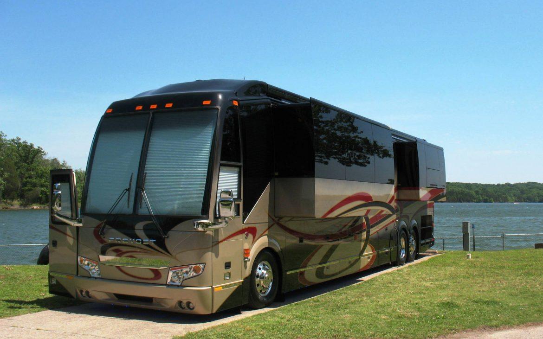 Huge black and brown modern RV parked