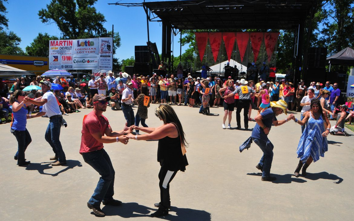 Many dancers enjoying themselves on wide dance floor