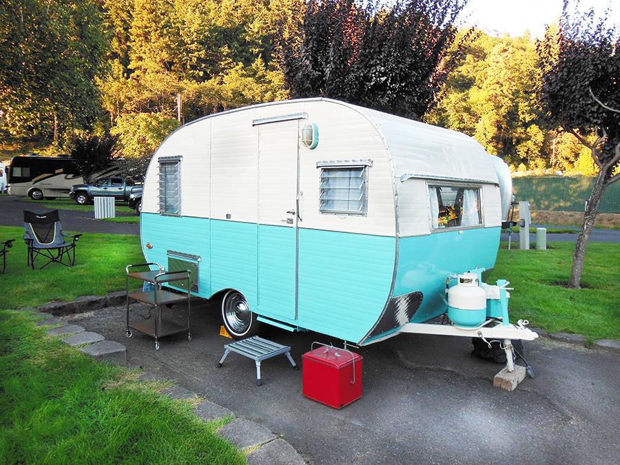 A small Shasta trailer in a cozy RV site.