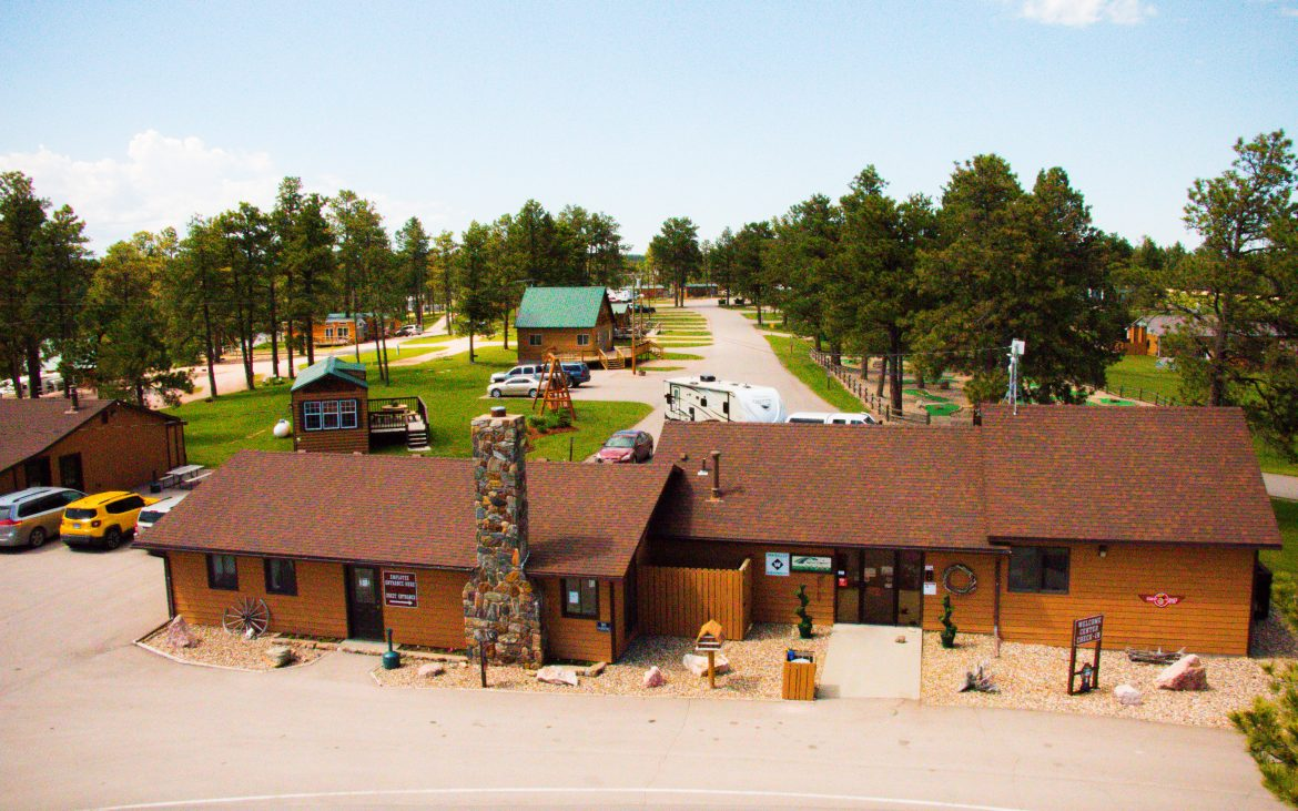 Aerial view of wooden cabins side-by-side