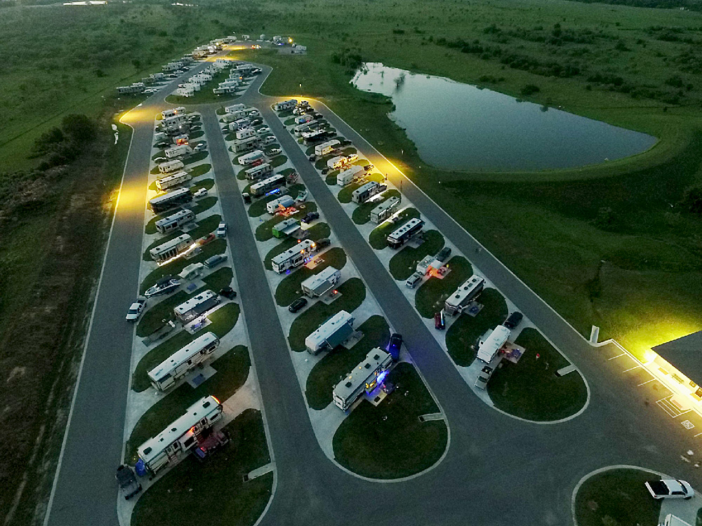 Twilight aerial view of many RVs parked in rows