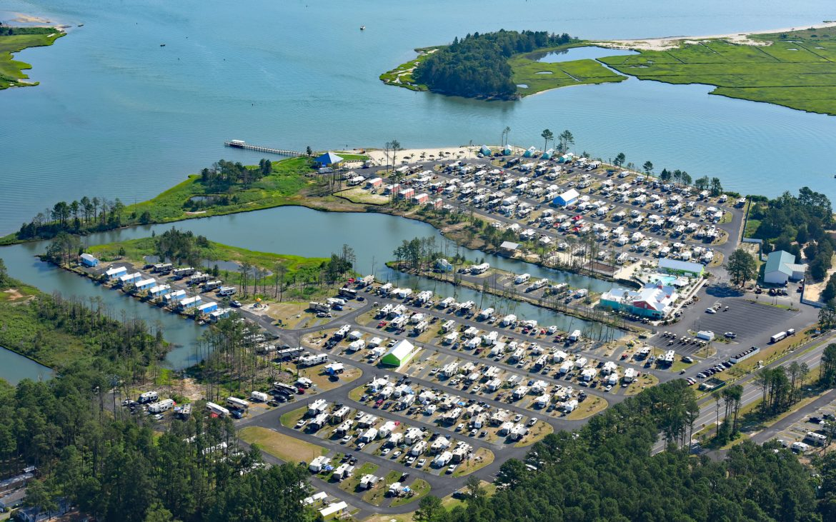 Stunning aerial photo of many RVs and Trailers parked along rows
