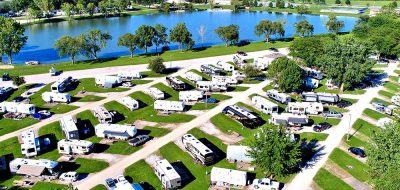 Large quantity of RV units parked at spots along roadways