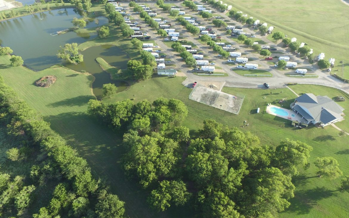 Aerial view of many RVs and trailers parked at spots