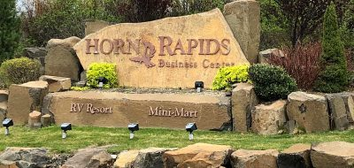 Large stone carved front entry sign to Horn Rapids RV Park