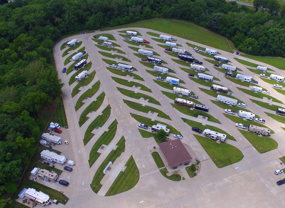 Aerial view of many RVs parked in spaces along paved roads
