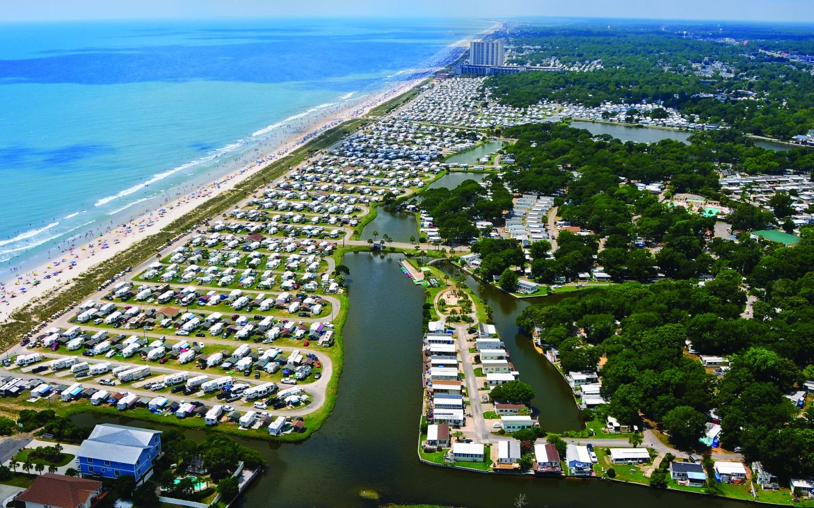 Sweeping aerial view of campground with ocean in background