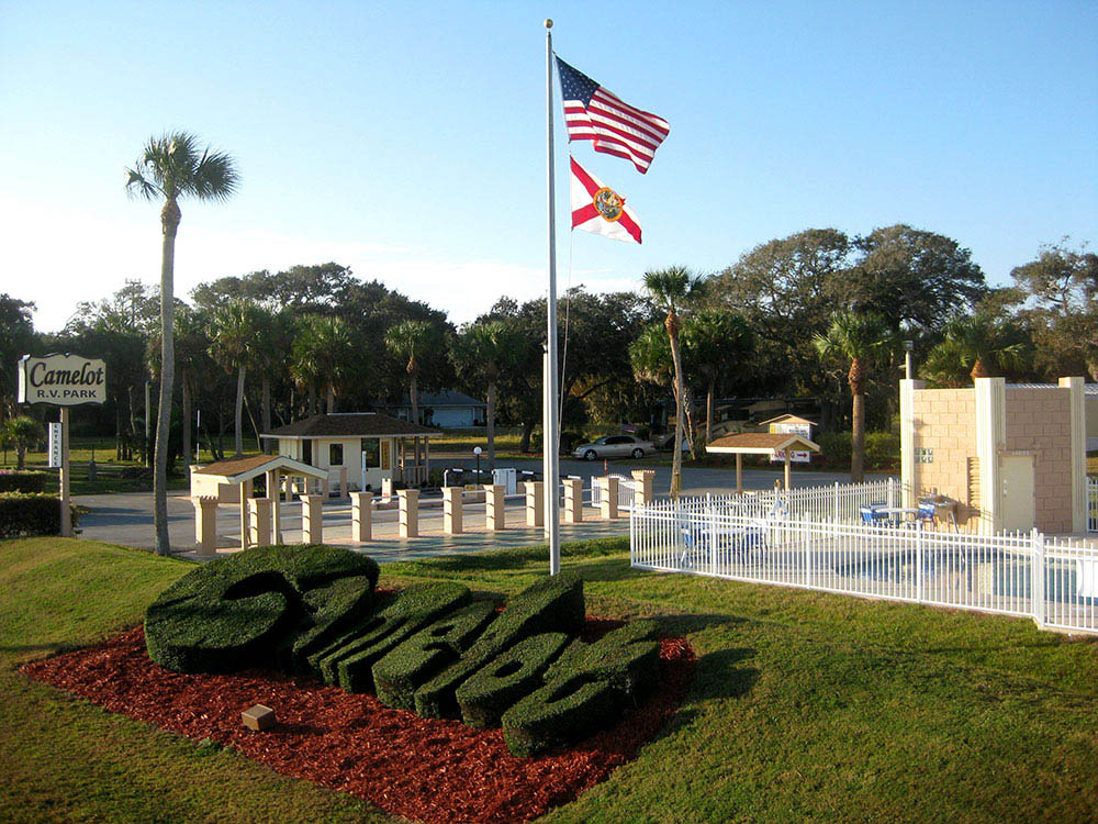 Camelot Park front entrance with flags and grassy sculptures