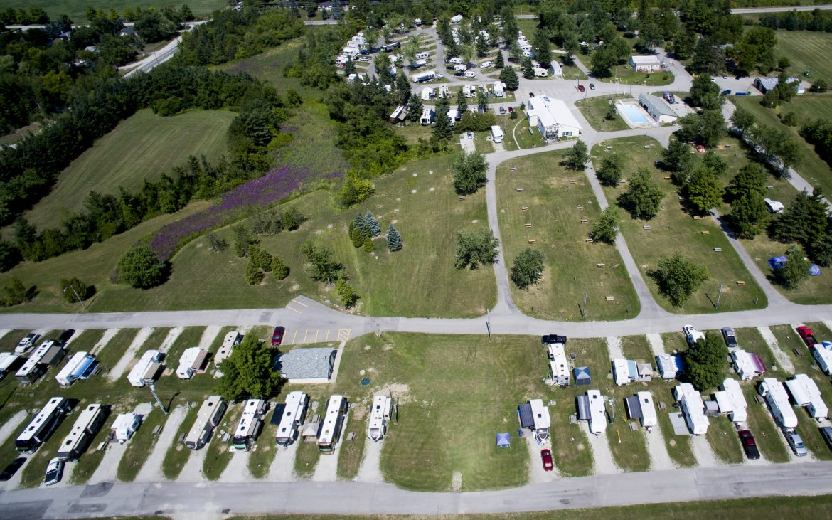 Aerial view of many RVs and trailers parked in stalls