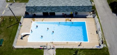 Campers frolicking in rectangular community pool
