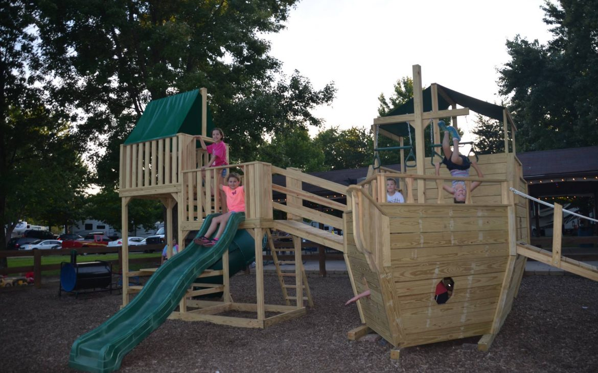 Wooden children's playground shaped like a pirate ship