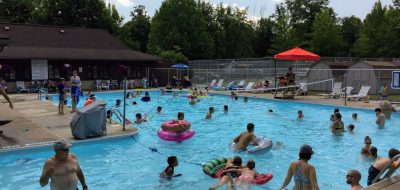 Many campers enjoying large public pool