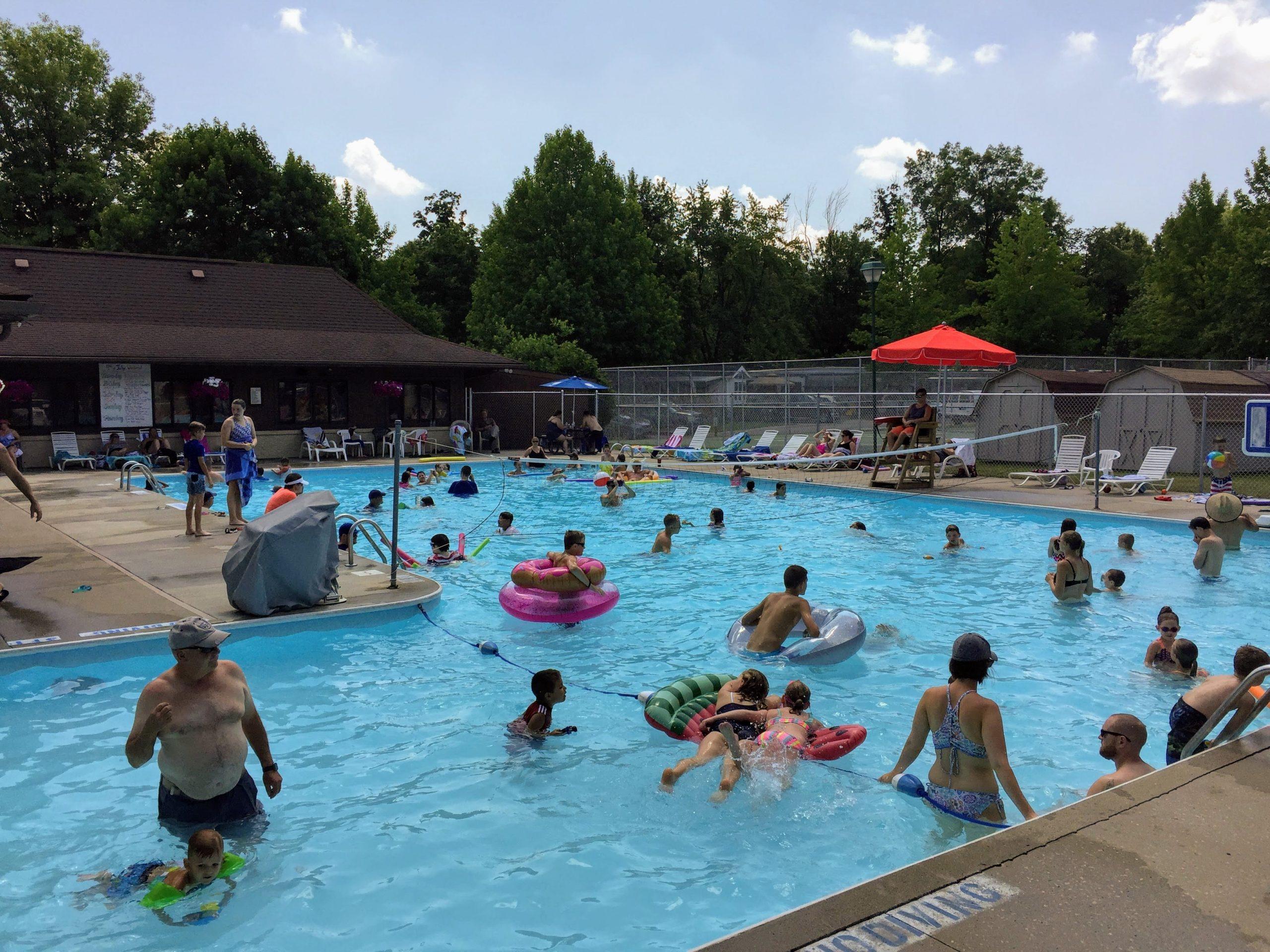 Many campers enjoying large public pool