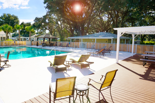 Inviting lounge chairs beside community pool