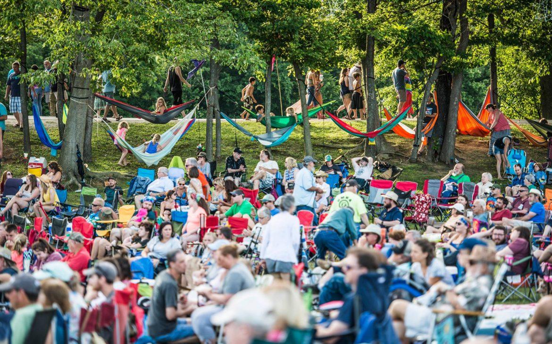 Outside festival with people relaxing in hammocks