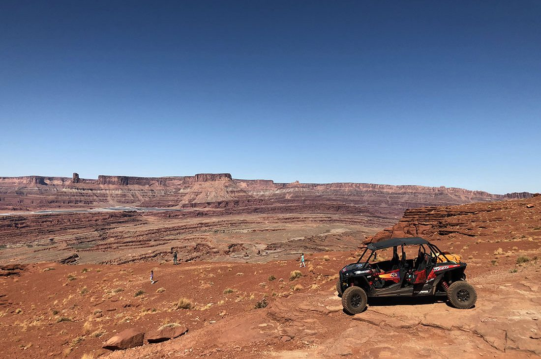 An ATV parked on rugged rocks in Arches National Park.