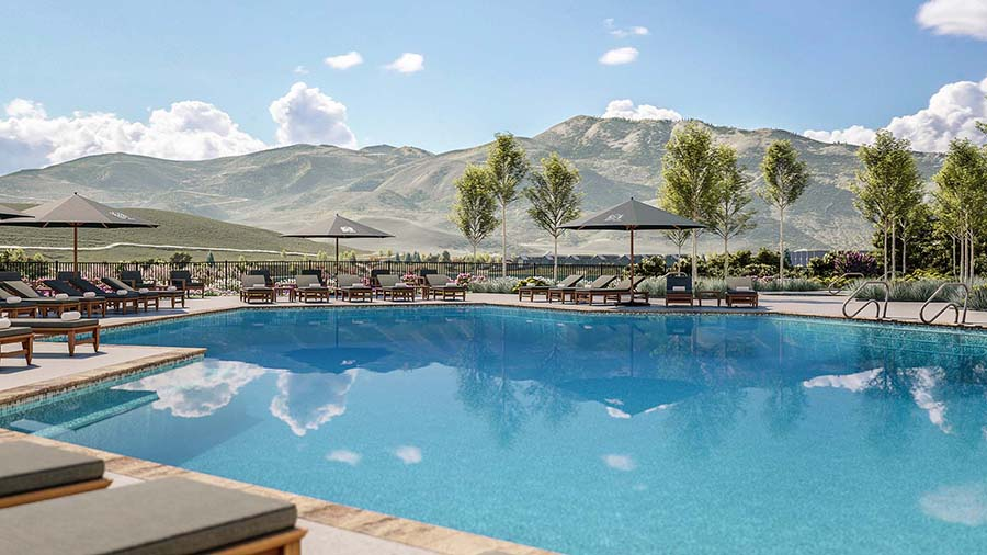 A swimming pool surrounded by Colorado Rocky Mountains.