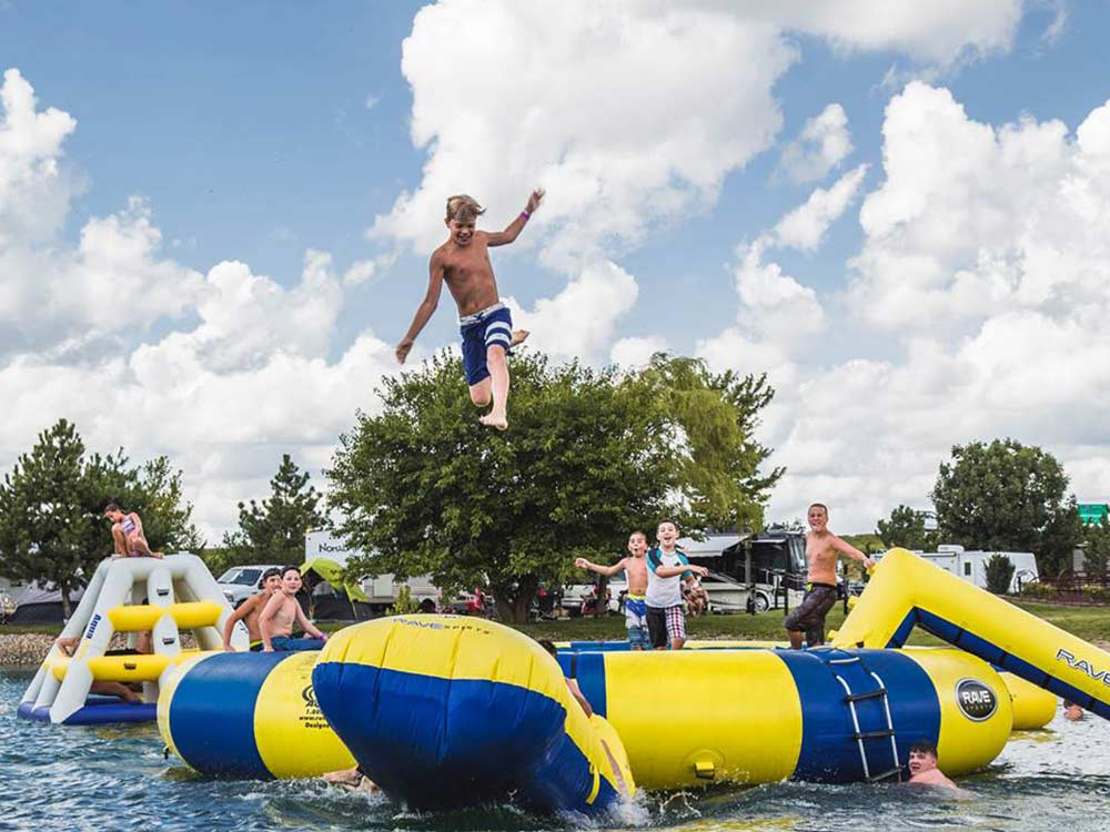 Boy jumping on water trampoline