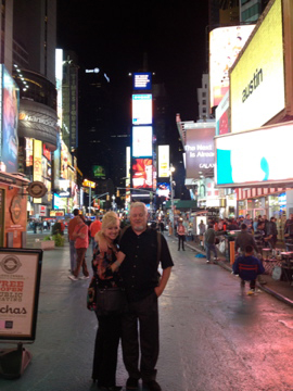 A couple on a sidewalk in Times Square in Manhattan.