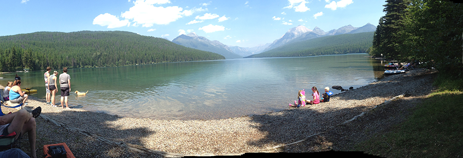 Beachside on a clear lake in Glacier National Park.