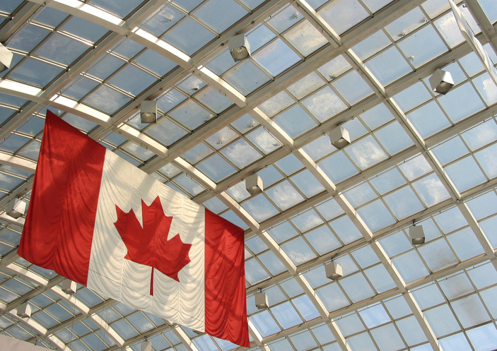 Red and white Canadian flag hanging from ceiling