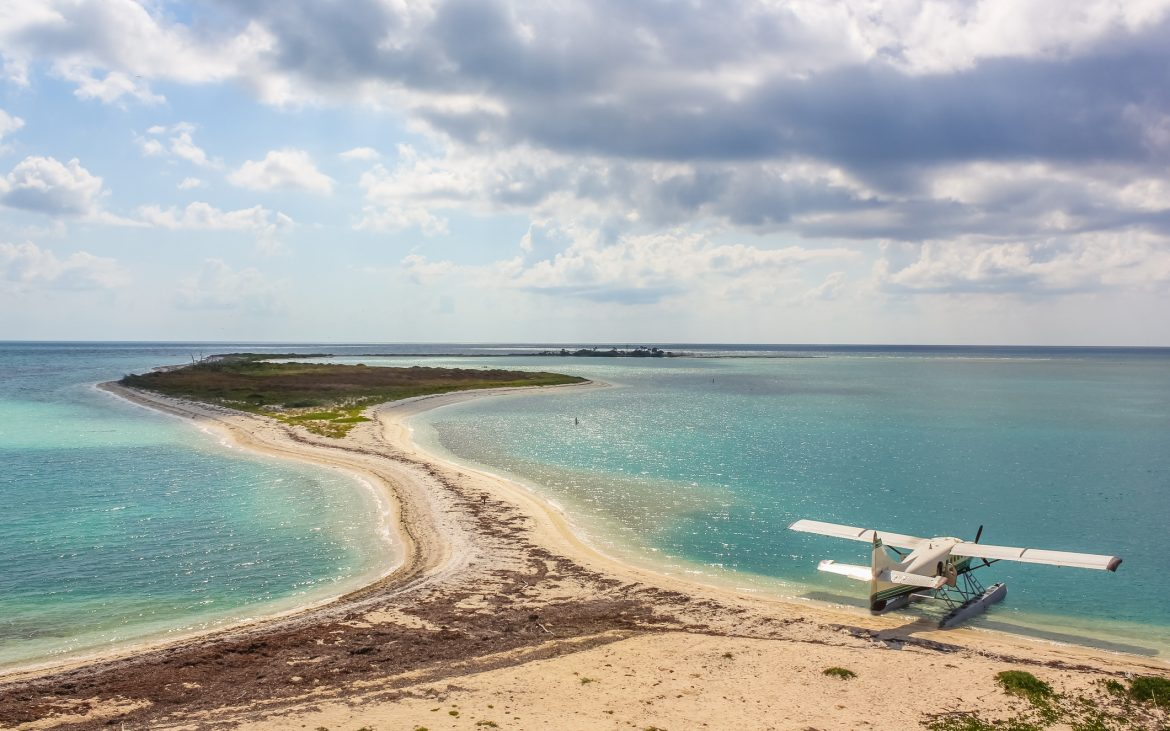 Sea plane docked at sandy beach in Dry Tortugas National Park