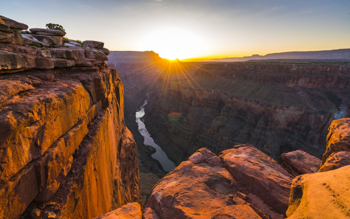 Beautiful sunrise at Grand Canyon with high cliffs and rocks