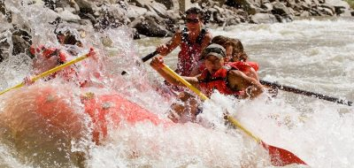 Rafters navigate the rapids in Glen Canyon, Colorado.