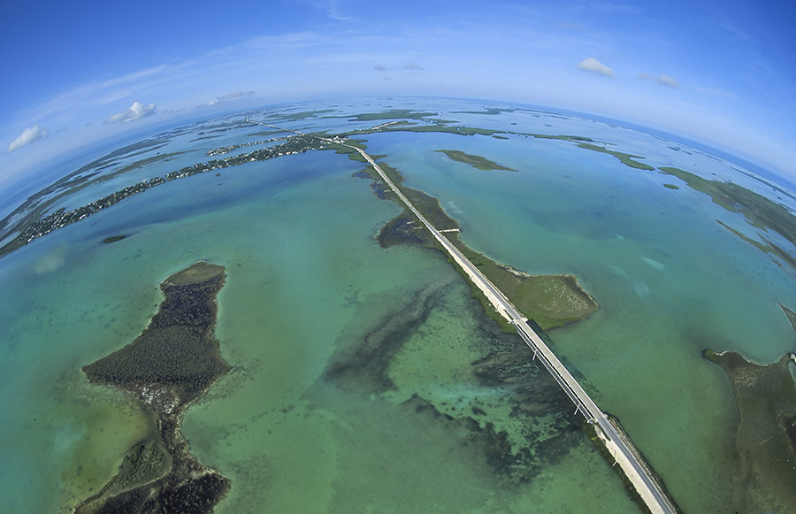 A spectacular aerial shot of the clear waters on either side of Florida's Overseas Highway.