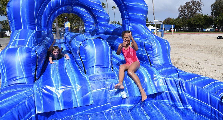Children playing on water slide
