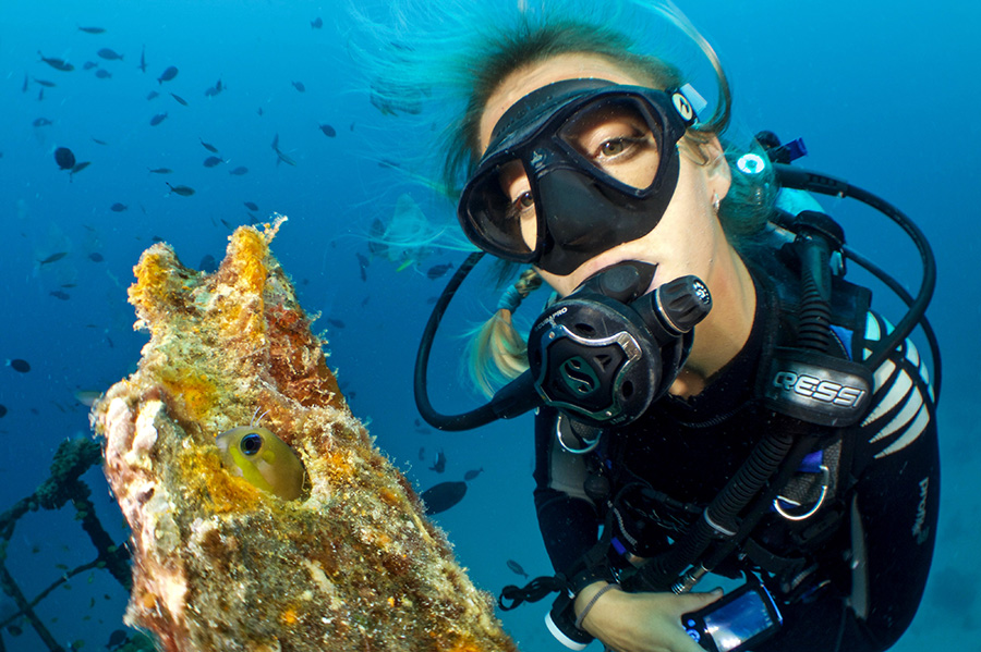 A diver explores a sunken ship in the Keys.