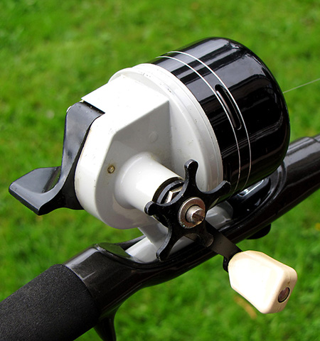 A black spincast reel.