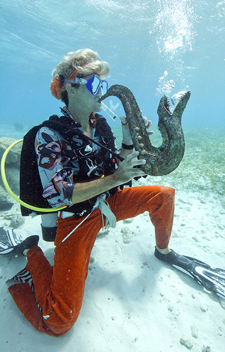 A diver plays a fish-shaped saxophone in the Lower Keys.