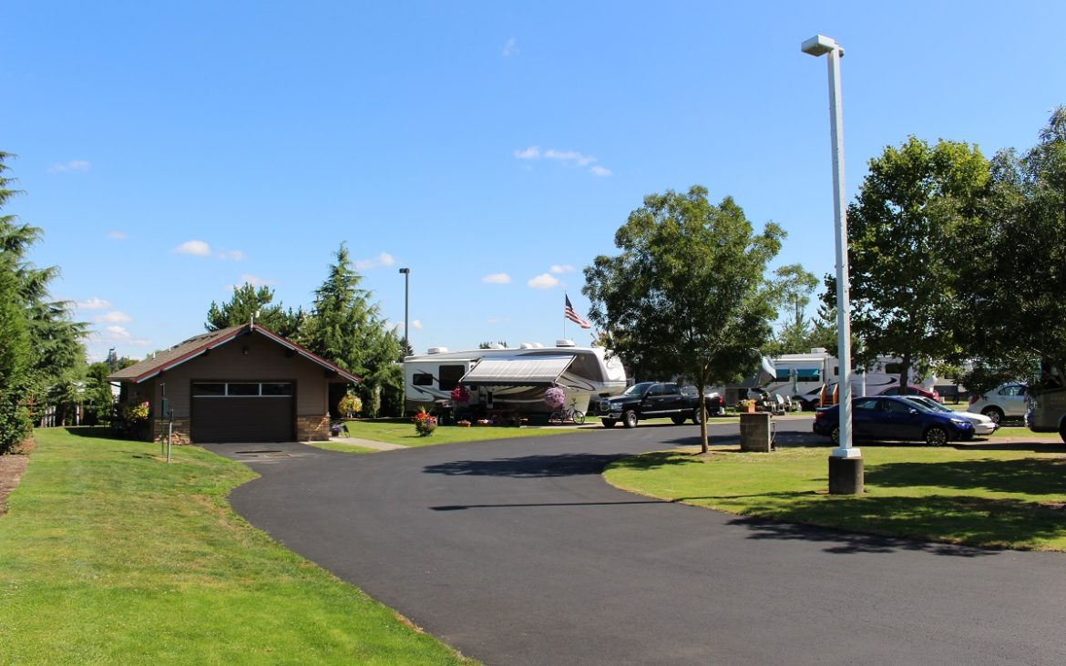 RVs and entry building along paved road
