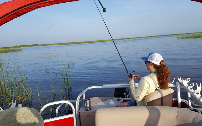 Woman on boat fishing