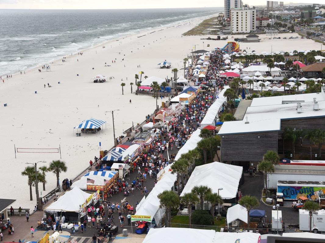 Crowded beach walk along white sandy shoreline