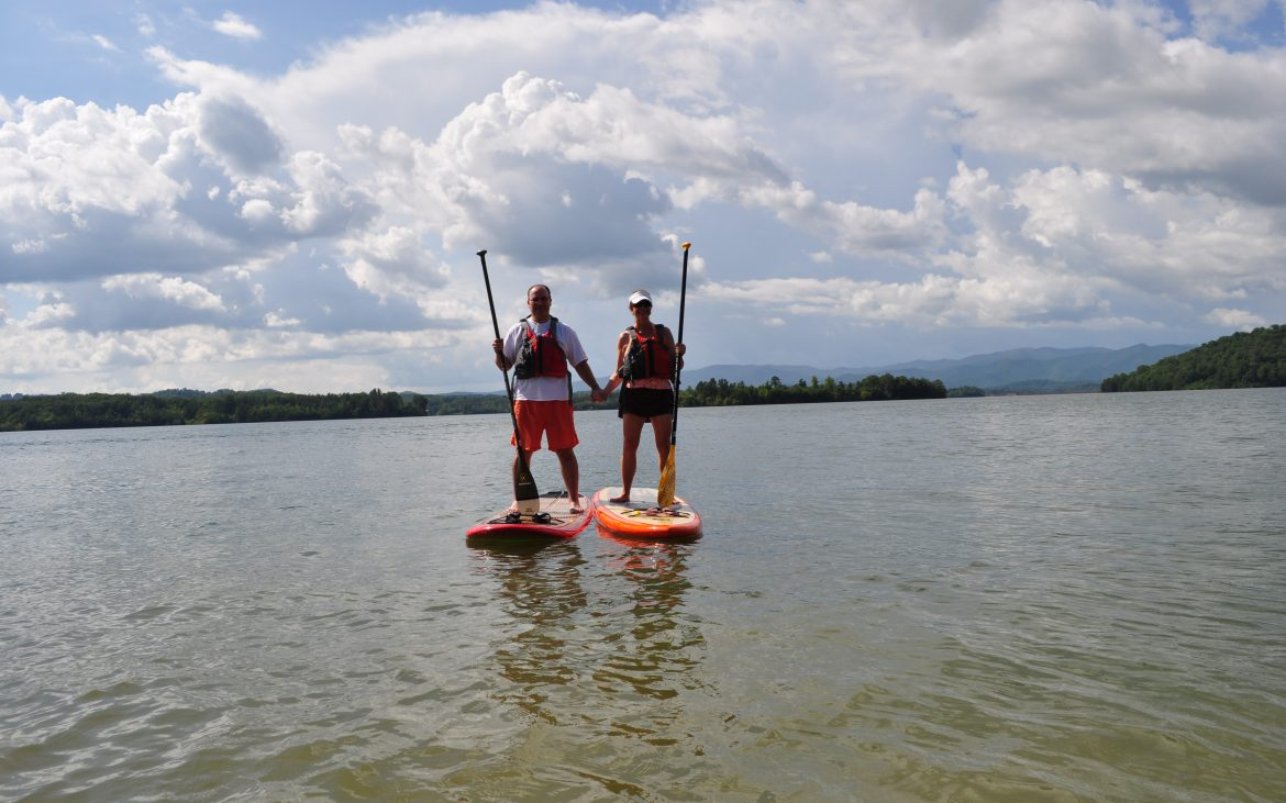 Campers standing on SUP
