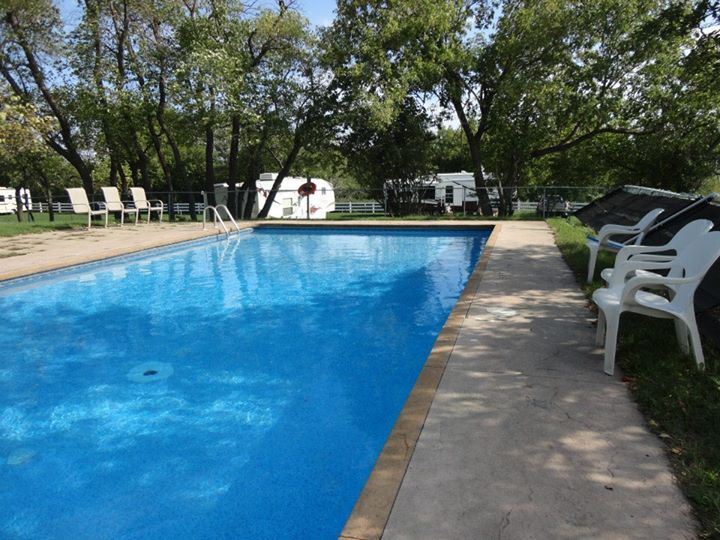 Peaceful community pool with RVs in background