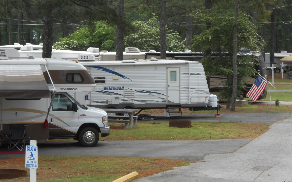 RV and Trailer parked along paved road