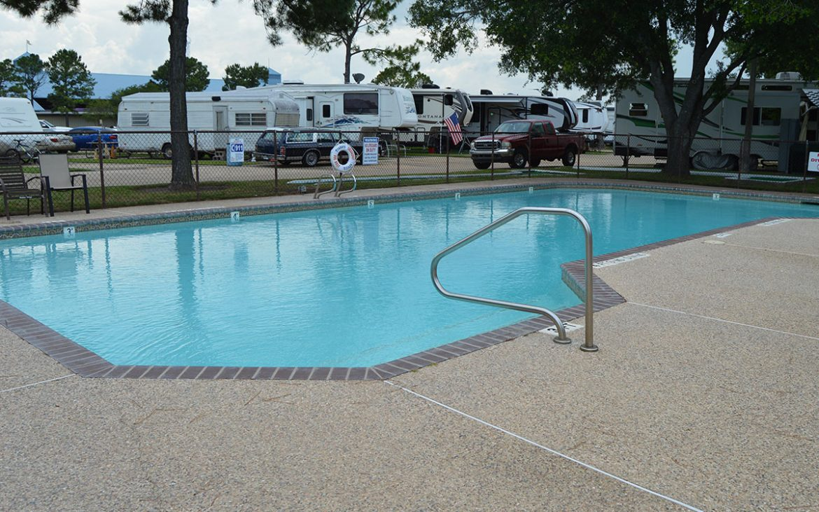 Clean community pool with RVs in background