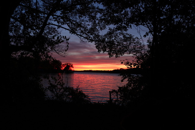 Beautiful orange and purple sunset over the water