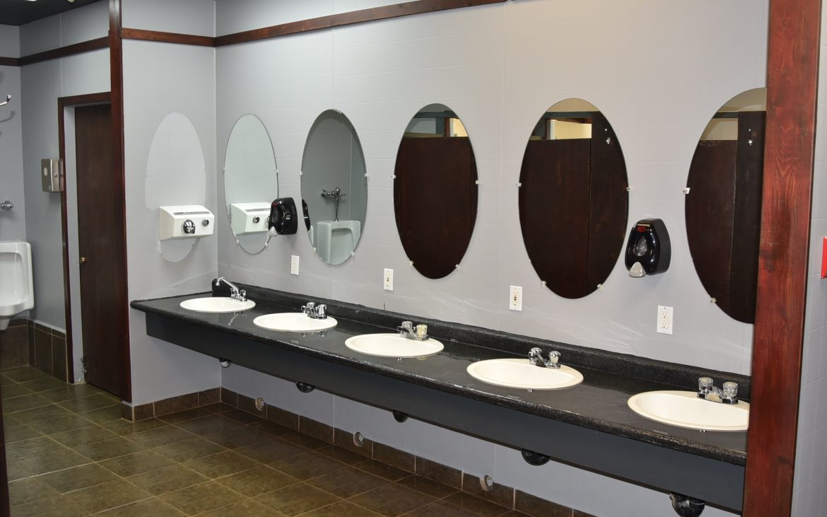 Multiple sinks and mirrors in public restroom